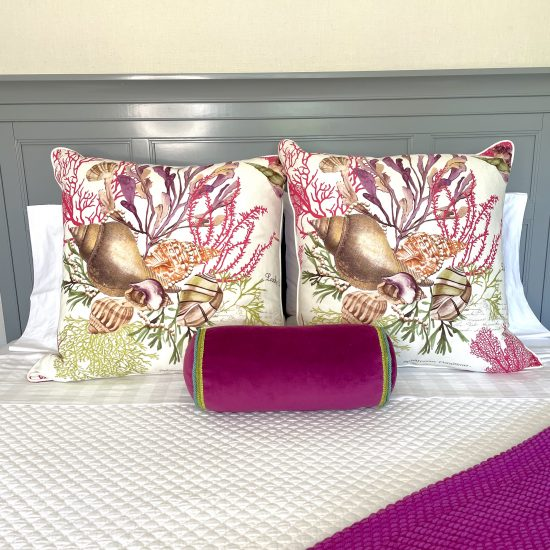 bed decorated with 2 jewels of the sea pillows and accent pillow in fuchsia
